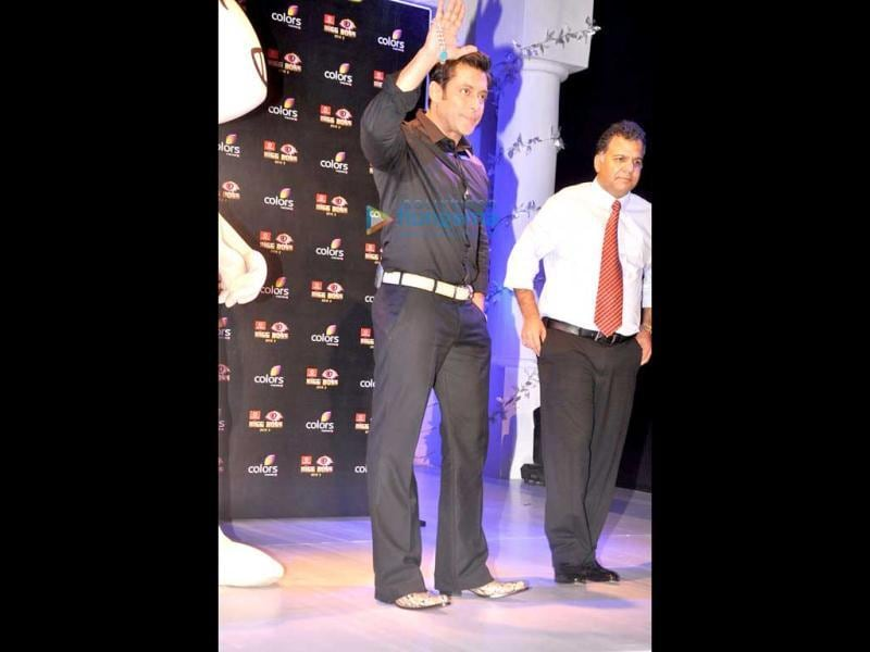 Salman Khan waves to media people at the launch of Bigg Boss 7.