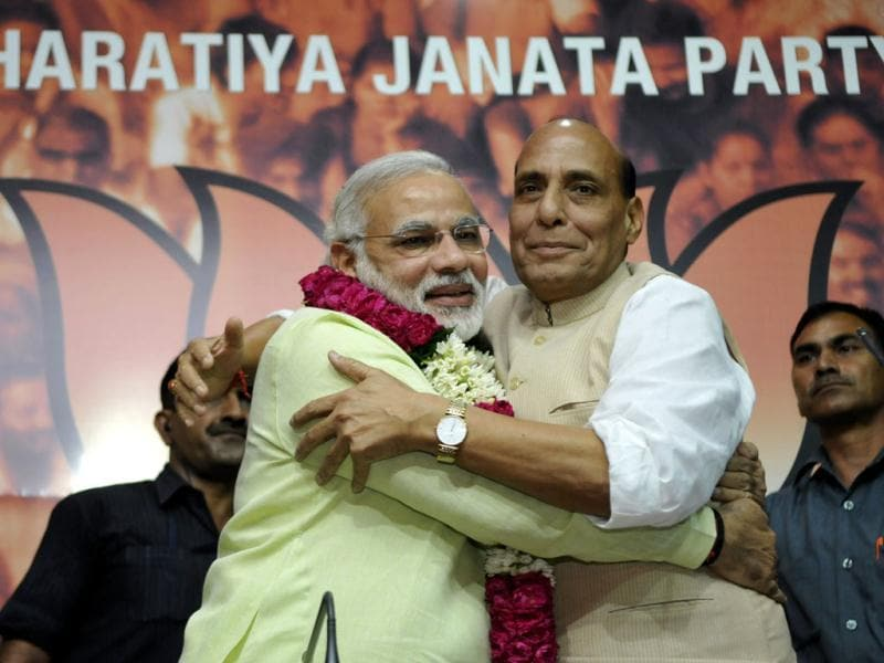 BJP president Rajnath Singh congratulates Narendra Modi after the party officially announced him as the prime ministerial candidate for the 2014 general elections. (Sonu Mehta/HT Photo)