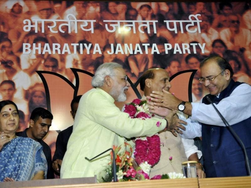 BJP leaders Rajnath Singh and Arun Jaitley congratulates Modi after the party officially announced him as the prime ministerial candidate for the 2014 general elections. (Sonu Mehta/HT Photo)