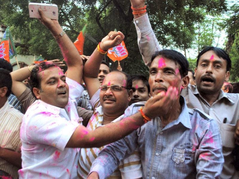 BJP activists and supporters celebrate in Allahabad after Narendra Modi was declared BJP's prime ministerial candidate on Friday. (PTI Photo)