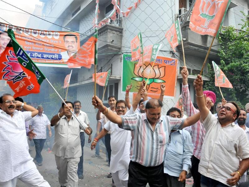 BJP activists and supporters celebrate in Amritsar after Narendra Modi was declared BJP's PM candidate on Friday. (PTI Photo)