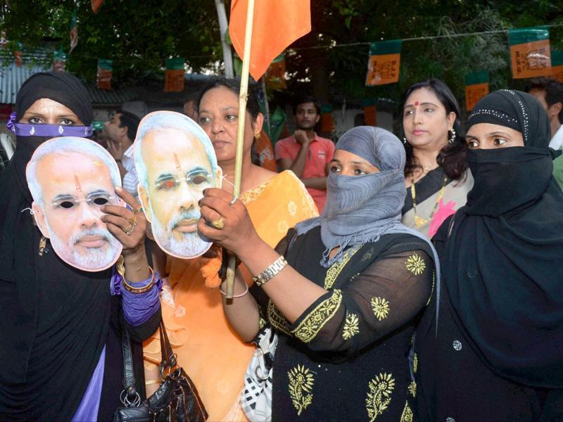 BJP supporters celebrate in Mumbai after Narendra Modi was declared BJP's PM candidate on Friday. (PTI Photo)