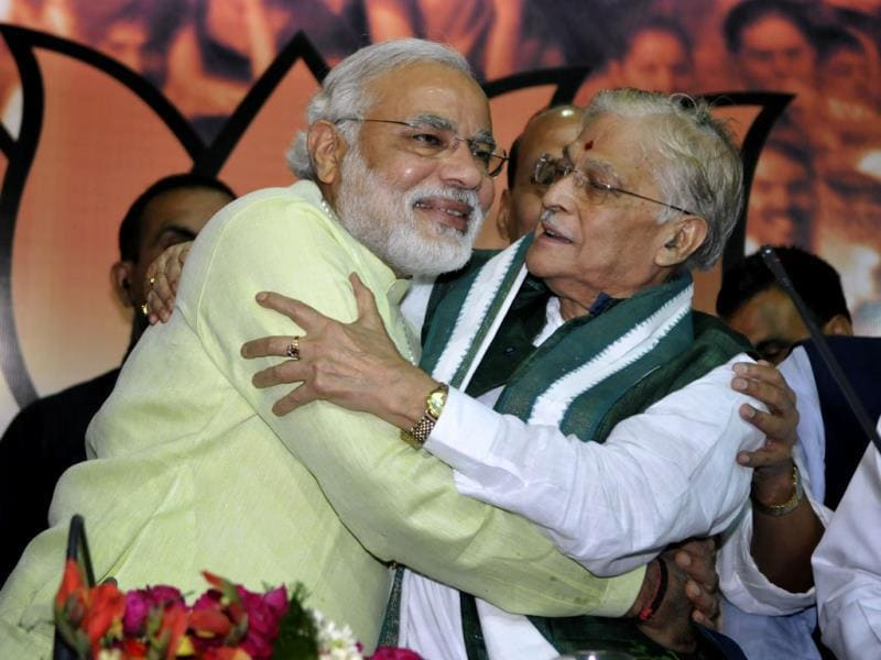 BJP leader Murli Manohar Joshi hugs Modi after the party officially announced him as the prime ministerial candidate for the 2014 general elections. (Sonu Mehta/HT Photo)