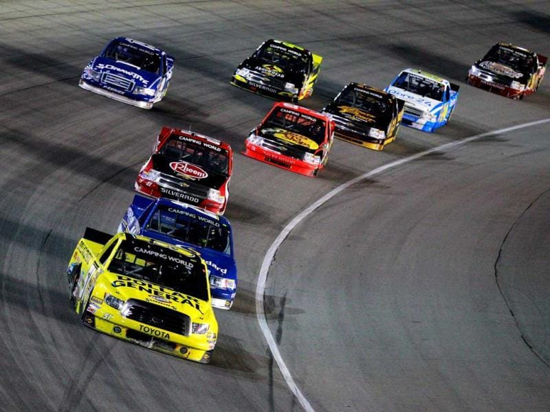 Kyle Busch, driver of the #51 Dollar General Toyota, leads a pack of trucks during the NASCAR Camping World Truck Series enjoyillinois.com 225 at Chicagoland Speedwayin Joliet, Illinois. (AFP Photo)