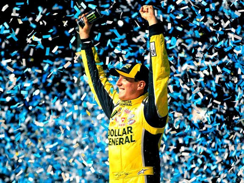 Kyle Busch, driver of the #51 Dollar General Toyota, celebrates in Victory Lane after winning the NASCAR Camping World Truck Series enjoyillinois.com 225 at Chicagoland Speedway in Joliet, Illinois. (AFP Photo)