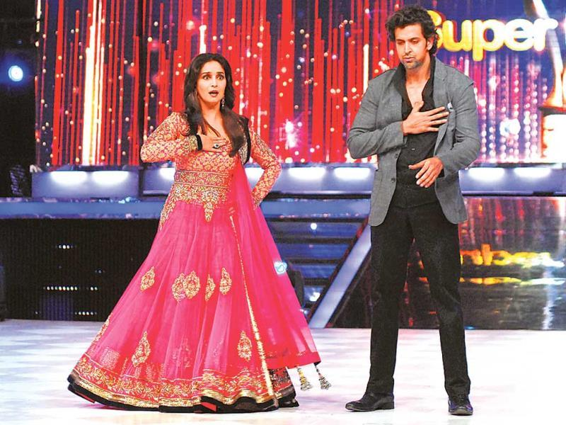 Dancing diva Madhuri Dixit's moves seem to have tired Hrithik Roshan. Or is it the Bollywood queen's charisma that made him sigh? (Photos: Prodip Guha)
