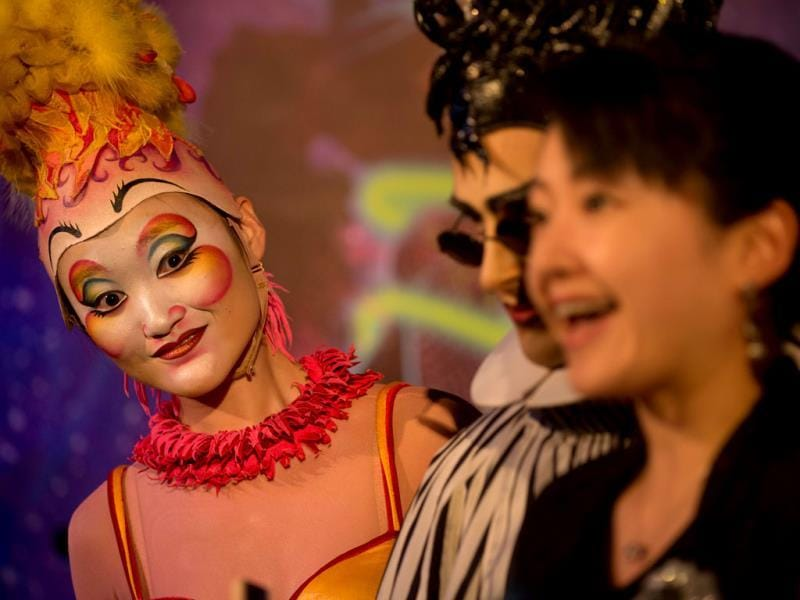 A performer from the circus act Cirque du Soleil poses for photos at a gala event in China. (AFP Photo)