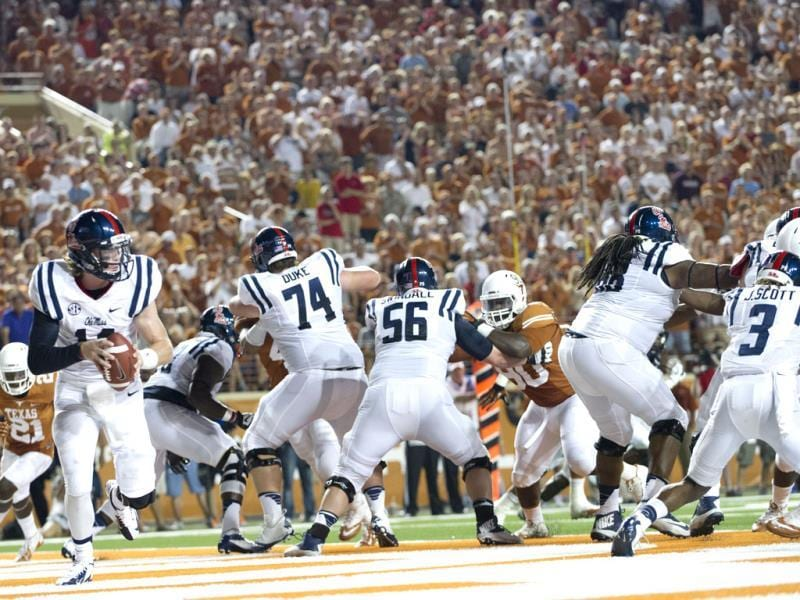 Bo Wallace #14 of the Mississippi Rebels scrambles in his own end zone against the Texas Longhorns at Darrell K Royal-Texas Memorial Stadium in Austin, Texas. (AFP Photo)