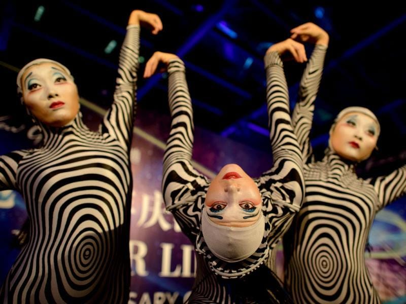 Performers from the circus act Cirque du Soleil poses for photos at a gala event in China. (AFP Photo)