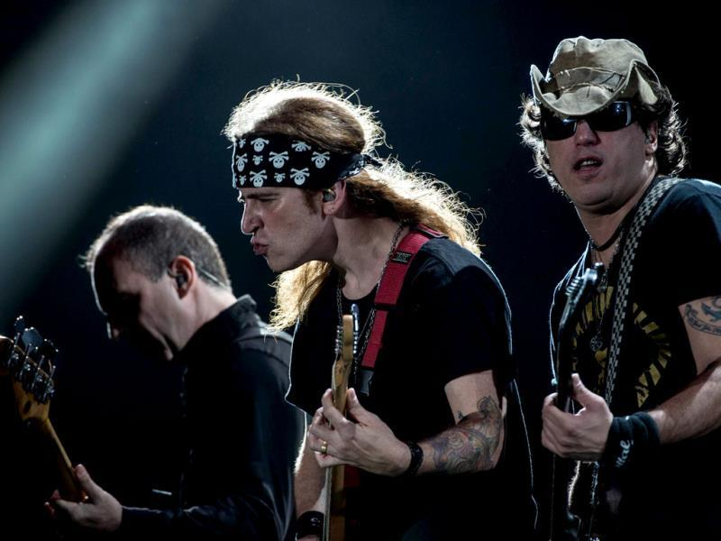 Yves Passarell (R), Fabiano Carelli (C) and Flavio Lemos of Brazilian Capital Inicial perform during the Rock in Rio music festival in Brazil. (AFP Photo)