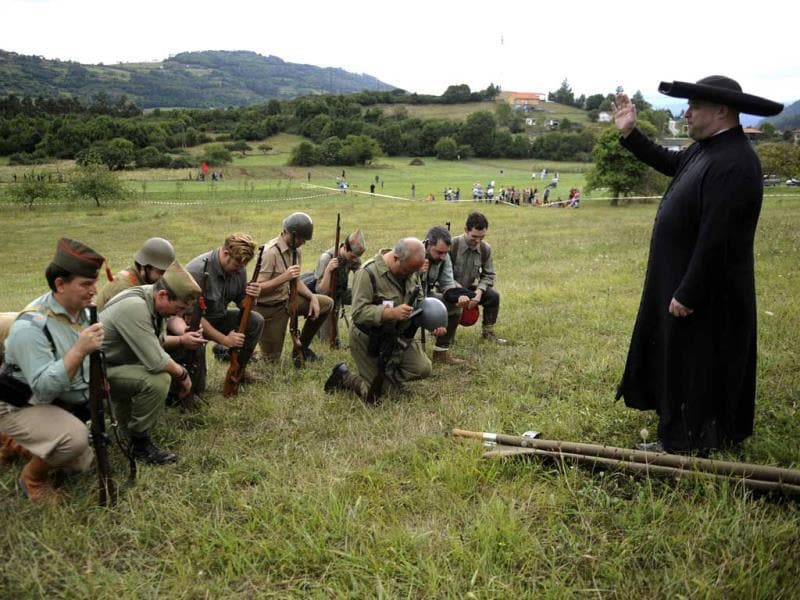 An actors takes part in a re-enactment of the