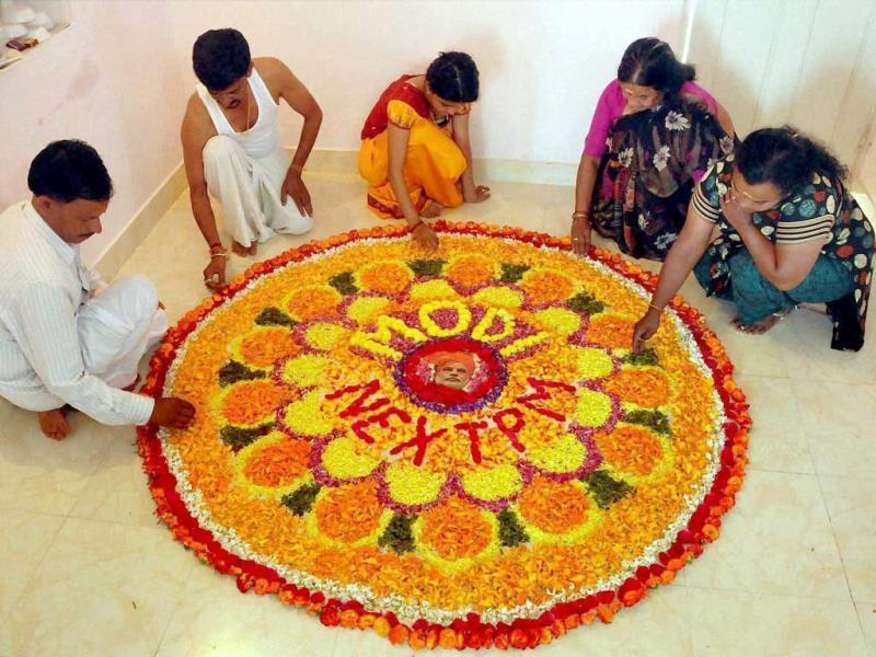 People make Pookalam (flower rangoli) with a message 'Modi next PM' on the occasion of Onam festival at Chikmagalur in Karnataka. (PTI Photo)