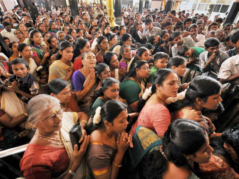 Devotees offering prayers at the Siddhapudur Ayyapan temple on the occasion of Onam festival in Coimbatore. (PTI Photo)