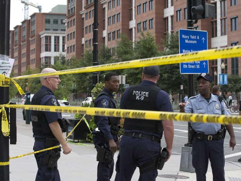 Police work the scene on M Street, SE in Washington near the Washington Navy Yard where one person got injured after a shooting at a Navy building.(AP Photo)