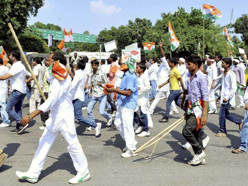Youth Congress members protesting against Muzaffarnagar riots in front of Vidhan Sabha in Lucknow on Monday. (PTI Photo)