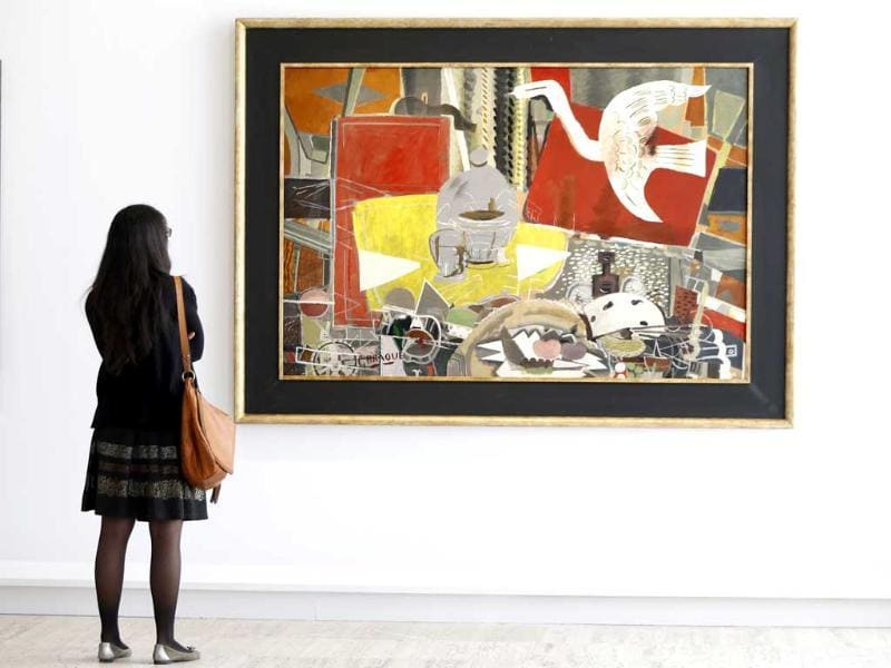 A visitor looks at the painting Atelier VIII by French artist Georges Braque during an exhibition at the Grand Palais Museum in Paris. Reuters photo