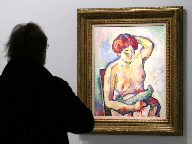 A visitor looks at a painting Nu assis by French artist Georges Braque during an exhibition at the Grand Palais Museum in Paris. Reuters photo