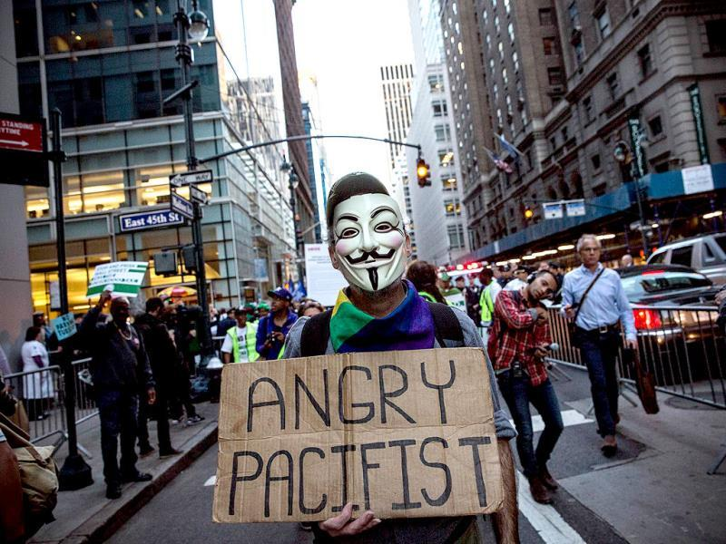 An Occupy Wall Street protester participates in a march from the United Nations building to Bryant Park in New York City. (AFP Photo)