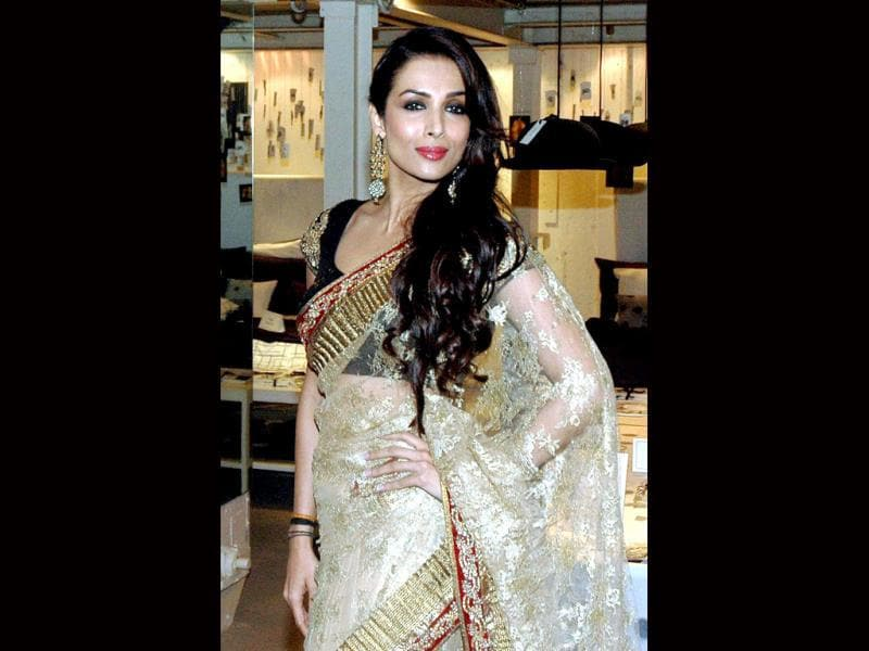 Mumbai: Bollywood actress Malaika Arora Khan poses for the preview to the 'Blenders Pride Fashion Tour 2013' in Mumbai on Tuesday. PTI Photo (PTI9_17_2013_000205B)