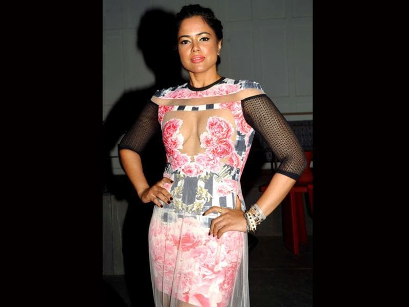Indian Bollywood actress Sameera Reddy poses for a photo during the announcement of The House of Style Preview to the Blenders Pride Fashion Tour 2013 in Mumbai on September 17, 2013. AFP PHOTO/ STR