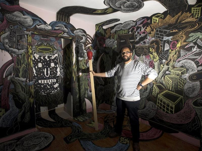 French artist Gilbert posing in a flat he decorated in a building set for demolition in 2014, where artists from all over the world occupy the 36 flats to create 'street art works'. (AFP Photo)