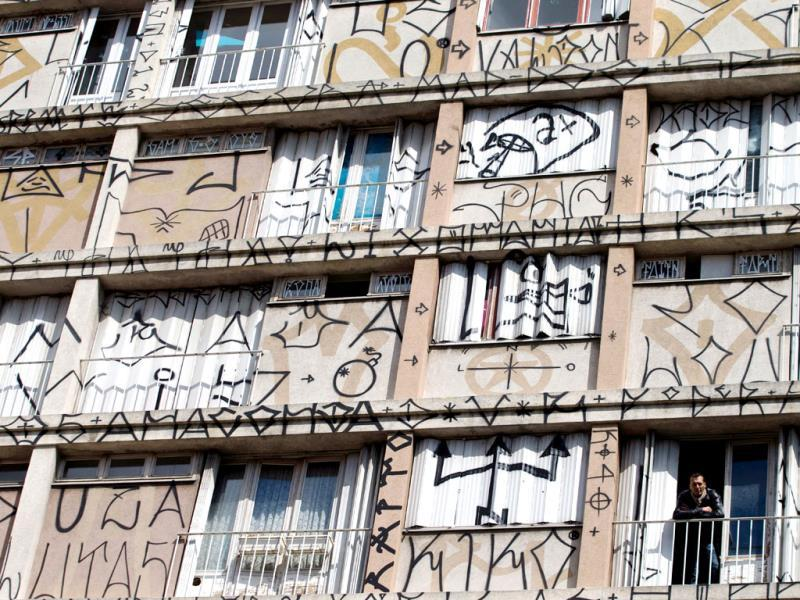 Gallerist Mehdi ben Cheikh posing at the window of the building known as 'La Tour' in Paris, set for demolition in 2014. Gallerist Mehdi ben Cheikh is behind the exibition Tour Paris 13 which will be opened to the public from October 1. (AFP Photo)