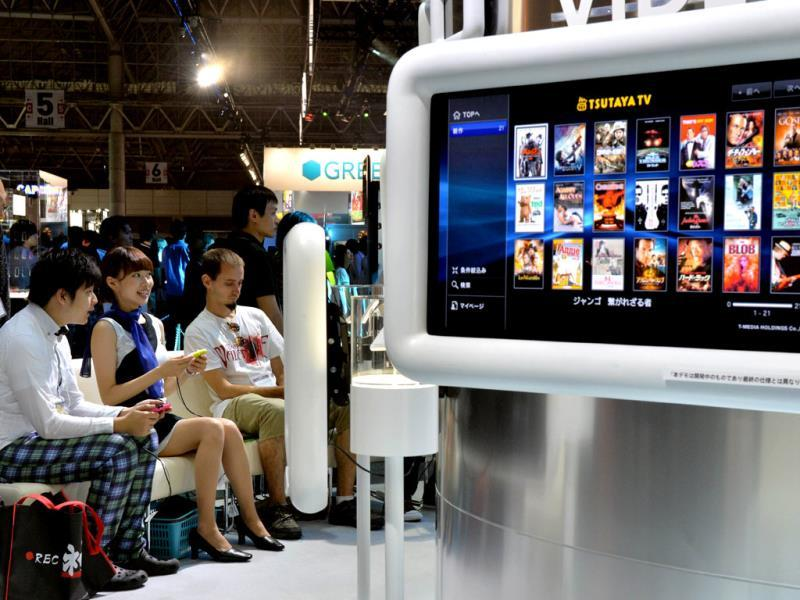 Visitors play Japanese videogame giant Sony Computer Entertainment's PS Vita TV at the Tokyo Game Show in Chiba, suburban Tokyo. Photo: AFP / Yoshikazu Tsuno