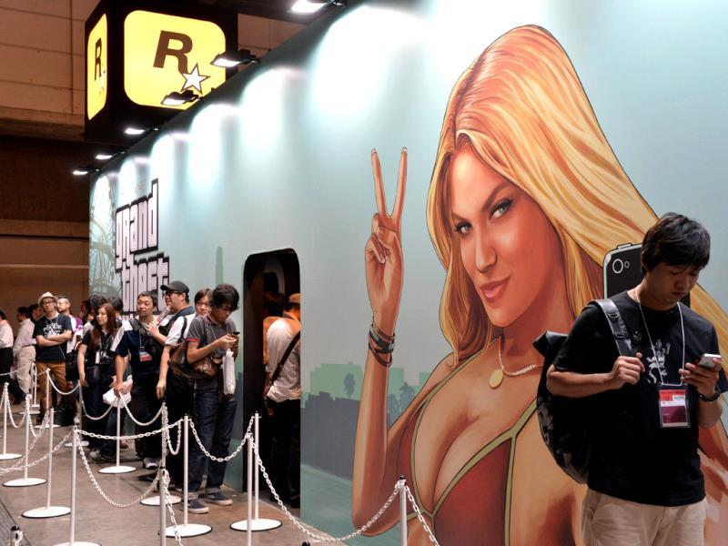Visitors queue to play the new Rockstar Games videogame