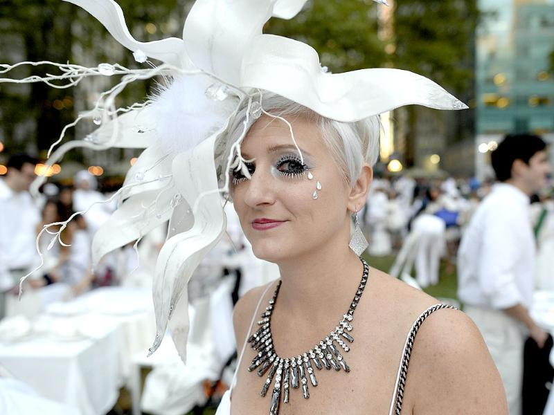 A rather dolled-up guest at the annual Diner en Blanc, imported from France and celebrated at an outdoor site -- always a landmark location. (AFP Photo)