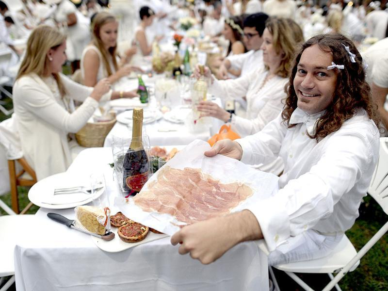 A guest at Bryant Park, New York, attending a chic pop-up style picnic celebrating the 25th anniversary of the annual Diner en Blanc. (AFP Photo)