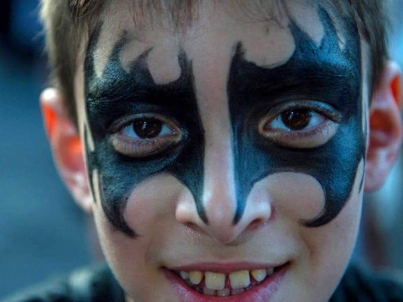 A boy with makeup poses during the Rock in Rio music festival in Rio de Janeiro, Brazil. (AFP PHOTO)