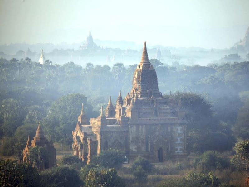 Ancient temples stand at sunrise in Bagan, central Myanmar. After closing its doors to the West for half a century, Myanmar has reopened, inviting all to come and discover its treasures, ancient palaces of kings long gone, legends and mysteries told in stone. Photo: AP/Khin Maung Win