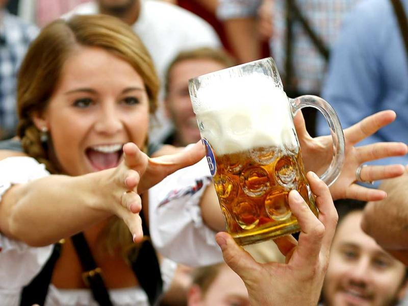 A visitor reaches for of the one of the first mugs of beer after the tapping of the first barrel during the opening ceremony for the 180th Oktoberfest at the Hofbraeu tent in Munich. Reuters photo