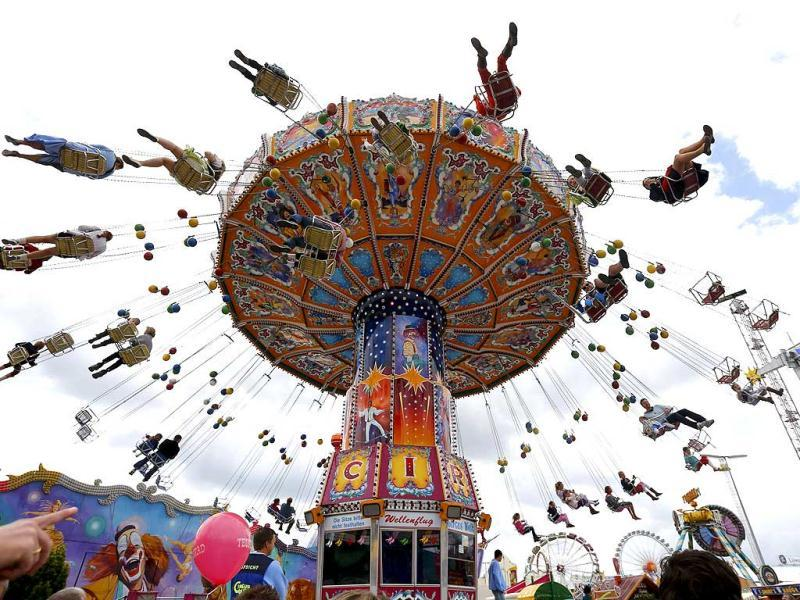 People enjoy a fairground ride during the opening day at 180th Oktoberfest in Munich. Reuters photo