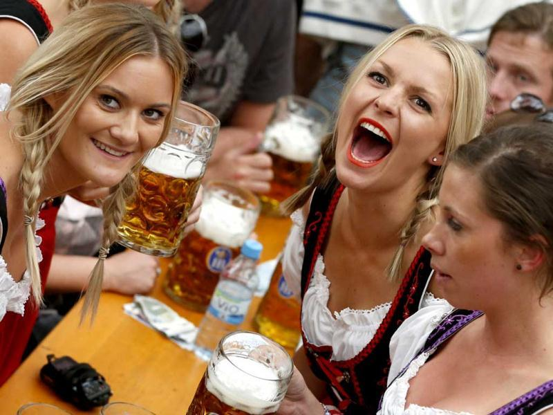 Women celebrate the opening ceremony in the Hofbraeuzelt beer tent of the 180th Bavarian Oktoberfest beer festival in Munich. AP photo