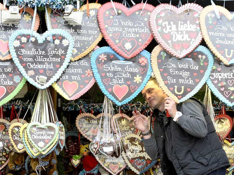 A vendor displays his selection of heart-shaped gingerbread before the opening of the Oktoberfest beer festival at the Theresienwiese in Munich. AFP photo
