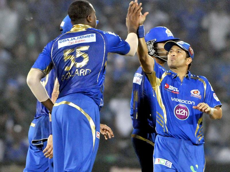 Mumbai Indians Sachin Tendulkar and Keiron Pollard celebrate the wicket of Rajasthan Royals batsman Sanju Samson during their Champions League Twenty20 match at Sawai Mansingh Stadium in Jaipur. (Mohd Zakir/ HT Photo)