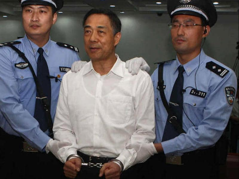 Ousted Chinese politician Bo Xilai (2nd R) is handcuffed after the announcement of his verdict inside the court in Jinan, Shandong province. (Reuters Photo)