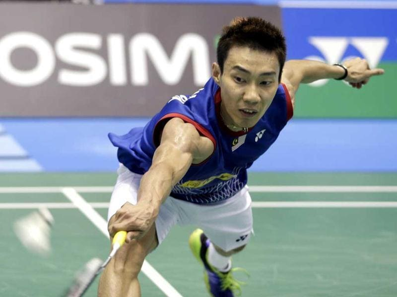 Lee Chong Wei of Malaysia returns a shot against Kenichi Tago of Japan during their final match of the Japan Open badminton championships in Tokyo. (AP Photo)