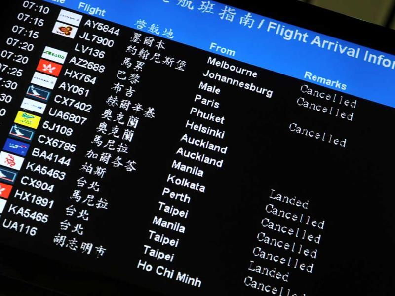 The arrivals screen displays cancelled flights at the downtown airport services following the passing of Typhoon Usagi in Hong Kong.(AFP Photo)