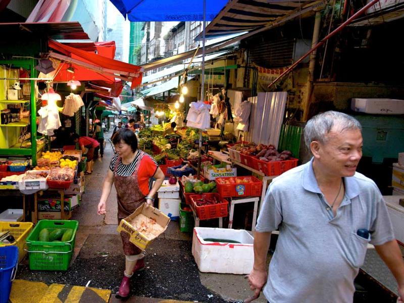People walk in a normally crowded morning market in the Soho district of Hong Kong after Typhoon Usagi moved through the region. (AFP Photo)