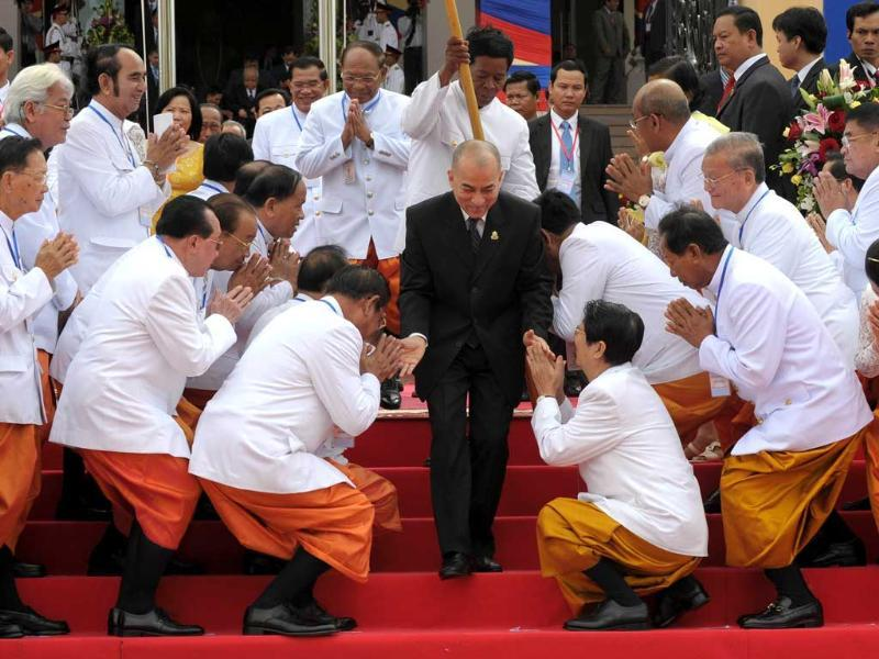 Cambodian King Norodom Sihamoni greets new parliamentarians during the first parliament meeting at the National Assembly building in Phnom Penh. (AFP Photo)