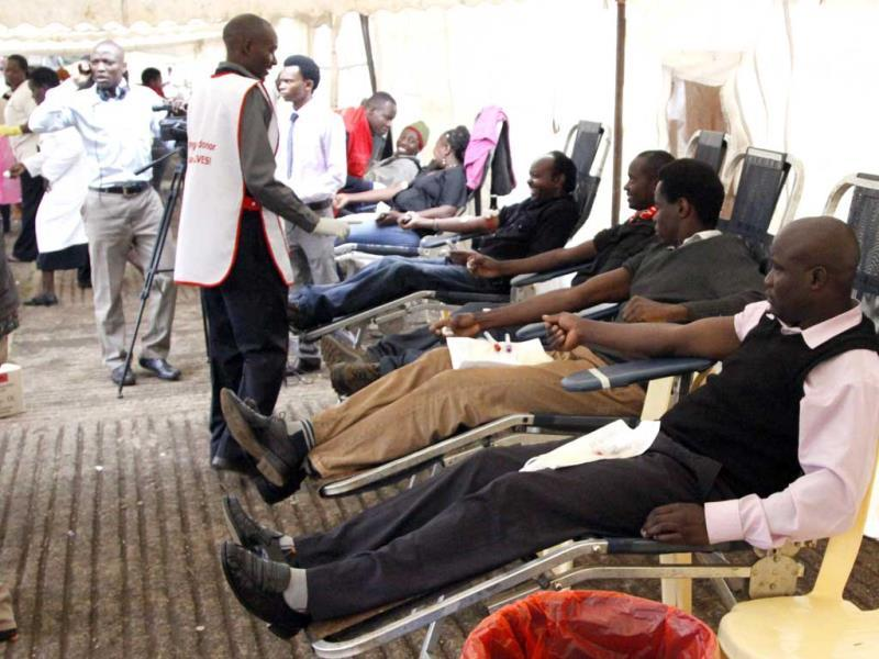 People donate blood for persons injured in the terror attack at the Westgate mall, at Uhuru Park in Nairobi. (AP Photo)