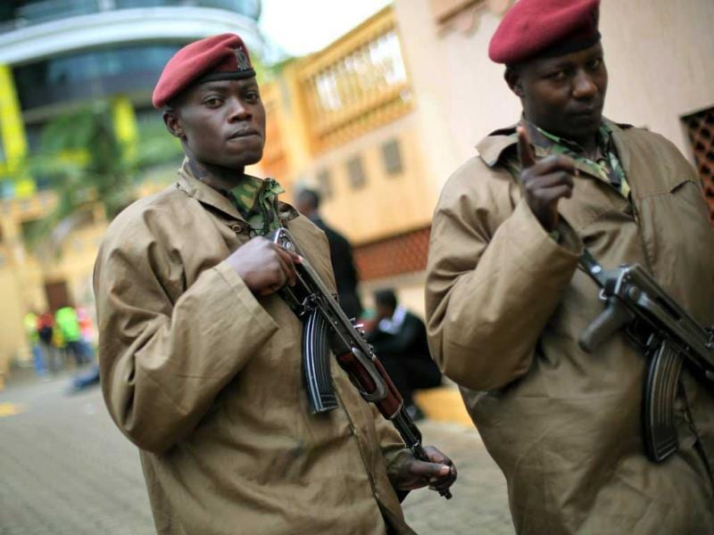 Kenyan security forces ask journalists to move back into a parking lot outside the Westgate mall in Nairobi. (AP Photo)