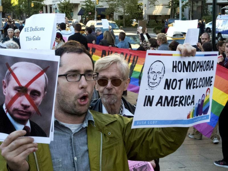 An anti-Putin protestor demonstrates in front of the Metropolitan Opera at Lincoln Center in New York. Putin who has upheld anti-gay laws passed by the Russian legislature.(AP photo)