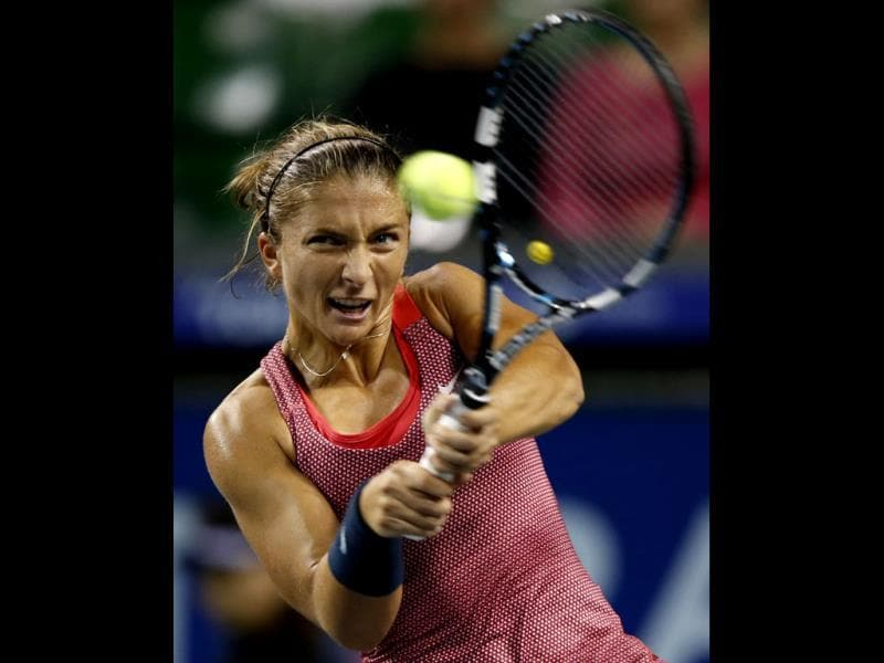 Sara Errani of Italy returns a shot against Svetlana Kuznetsova of Russia during their women's singles match at the Pan Pacific Open tennis tournament in Tokyo. (Reuters photo)