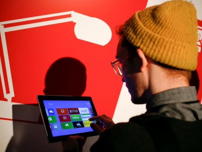 A member of the media works on a Surface 2 tablet during the launch of the Microsoft Surface 2 tablets in New York. Photo: Reuters/Shannon Stapleton