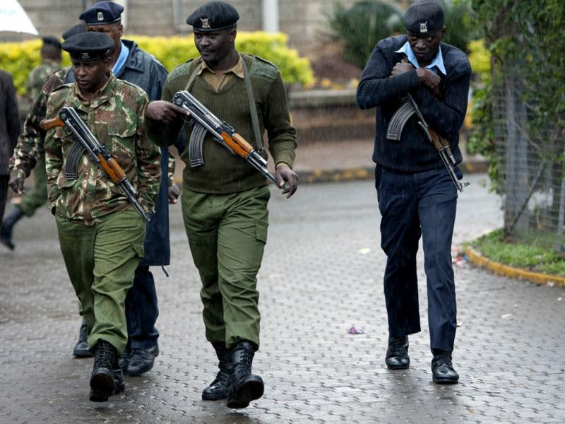 Kenyan army soldiers and police officers patrol near the Westgate Mall in Nairobi, Kenya. (AP Photo)