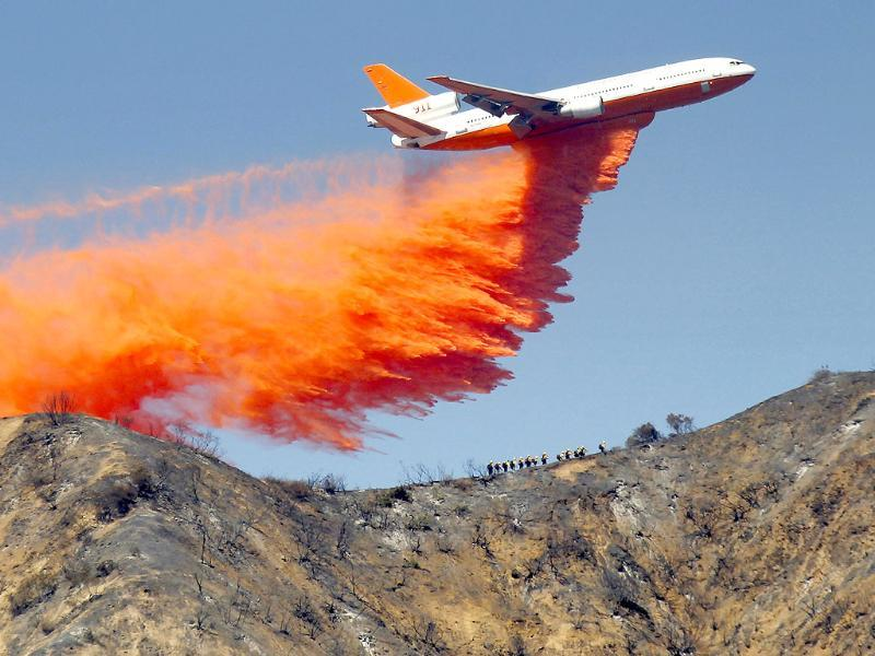 A tanker drops fire retardant on a wildfire in the San Gabriel Mountains in Azusa, California. (AP Photo)