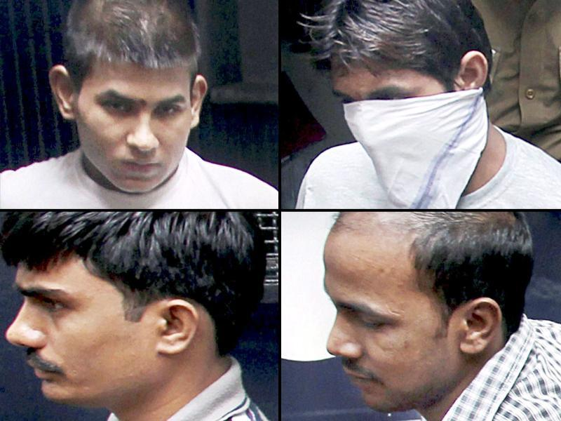 File photo: Gang-rape convicts Vinay Sharma, Pawan Gupta (face covered), Akshay Thakur and Mukesh Singh (clockwise from left) being taken to high court in New Delhi. (PTI Photo)